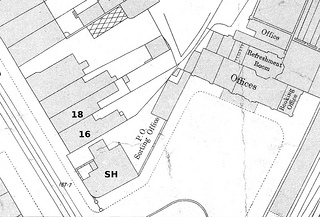 An extract from a greyscale map showing the same area with a different configuration of buildings.