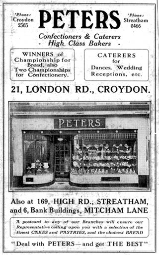 "A black-and-white advert for Peters bakery at 21 London Road. At the top it states that Peters are ""Winners of championship for bread, also two championships for confectionery."" A photograph of the shopfront shows two curved front windows with baked goods on display, and a door in the middle."
