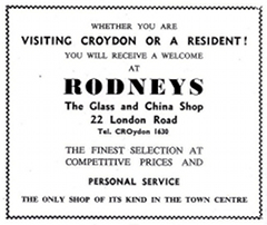 "A black-and-white advertisement with text in various fonts and sizes reading: ""Whether you are visiting Croydon or a resident! You will receive a welcome at Rodneys / The Glass and China Shop / 22 London Road / Tel. CROydon 1630 / The finest selection at competitive prices and personal service / The only shop of its kind in the town centre""."