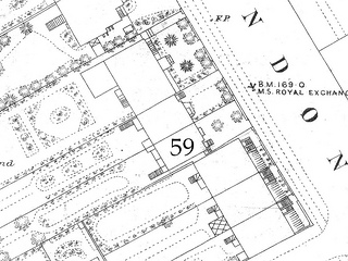 "A section of a printed black-and-white line map showing details of houses along one side of a road.  One of them has been marked ""59""; this is shown with a front garden including two trees."