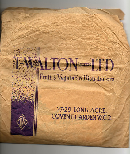 "A creased brown paper bag with text reading: ""T Walton (London) Ltd / Fruit & Vegetable Distributors / 27–29 Long Acre, Covent Garden W.C.2."""