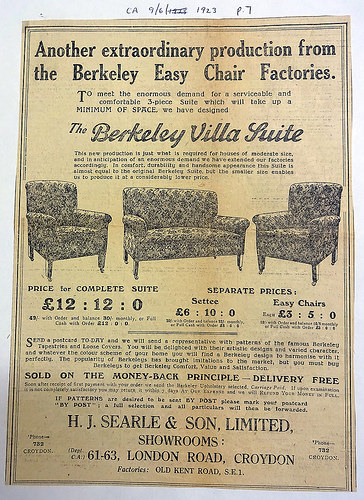 "Advert headed ""Another extraordinary production from the Berkeley Easy Chair Factories.""  Drawings of a sofa and two armchairs are shown in the middle of text describing ""a serviceable and comfortable 3-piece Suite which will take up a MINIMUM OF SPACE [...] for houses of moderate size"".  At the bottom is the address: ""H. J. Searle & Son, Limited, Showrooms: 61–63, London Road, Croydon"" and the note: ""Factories: Old Kent Road, S.E.1""."