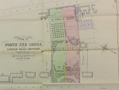 "A paper map entitled ""Plan of North End Lodge, London Road, Croydon.  To be Sold by Auction on Monday 15th May, 1893.  By Robt W Fuller Moon & Fuller, in conjunction with Hooker & Webb.""  The plan shows three lots, coloured in red, green, and purple; North End Lodge is part of Lot 1 and is noticeably bigger than the surrounding houses.  The grounds (Lots 1 and 2) are also notably extensive."