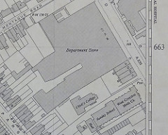 "A black-and-white map showing a large ""Department Store"" and a smaller building labelled ""Clark's College"" below it."