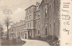 "A postcard image of a three-storey building with a grand pillared entrance.  ""Croydon.  General Hospital."" is printed in the top right corner, and under this ""Many Happy Returns of the Day."" is handwritten in ink."