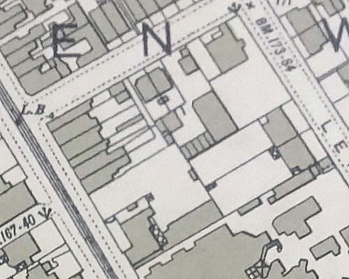A map extract showing a small built-up area, with buildings indicated by solid shading.