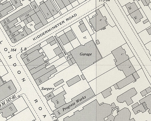 "Another extract showing the same area, this time with street numbers on some of the building as well as wording reading ""Surgery"", ""Garage"", ""Progress Works"", etc."