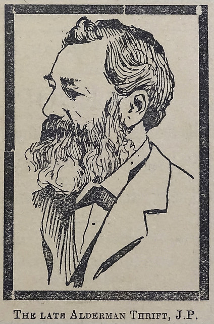 A monochrome line drawing of a white man with a full beard and moustache and a slightly receding hairline.  He is wearing a suit and looking off to the left.