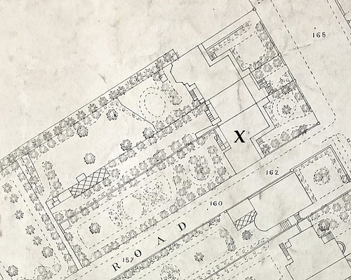 "A large-scale map showing houses with gardens.  One of the houses is marked with an ""X""."