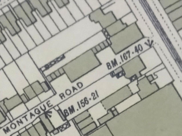 A small section of a printed map, showing the same area as the previous.  The southernmost of the three houses has been extended forward to the pavement line, and more buildings have been constructed behind it, fronting on Montague Road.