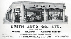 "A black and white advert with a drawing of a car showroom at the top.  The showroom is located on a corner, and the entrance door is at a cut-off corner of the building.  Below is printed: ""Smith Auto Co. Ltd. / Humber / Hillman / Sunbeam Talbot / We Specialize in the Sale and Servicing of these Cars / 145 London Road, Croydon / Servicing Station & Spares: Montague Road""."
