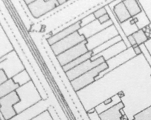 Another monochrome map excerpt; in this, the three houses shown in the previous image have been split and extended forwards.  Echoes of their previous shapes can be seen at the backs.