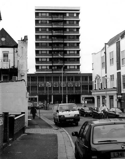 The same tower block as in the first picture, seen in the distance from some way down a side road.  This angle gives a clearer view of the six square zodiac-themed plaques on the frontage.