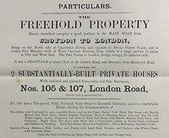 "A printed page in a variety of fonts giving ""Particulars"" of a ""freehold property"" comprising ""2 substantially-built private houses"" with ""enclosed and planted Forecourts, and Side Entrances""."