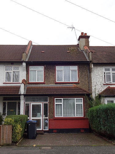 A small terraced house with modern PVC windows (which clearly post-date the house by some time).