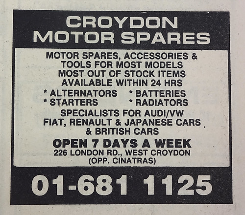 "A newspaper advert reading: ""Croydon Motor Spares / Motor spares, accessories & tools for most models / Most out of stock items available within 24 hrs / Alternators / Batteries / Starters / Radiators / Specialists for Audi/VW / Fiat, Renault & Japanese cars & British cars / Open 7 days a week / 226 London Rd., West Croydon (opp. Cinatras) / 01-681 1125""."